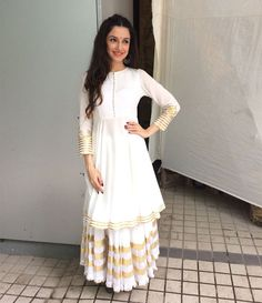 Divya Khosla Kumar Proves That White & Gold Will Never Get Old!