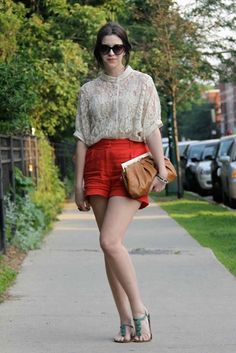 Love the linen shorts - she's paired them bravely...