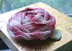 simple and down to earth fabric flower brooch in watermelon colors by ninainflorida, via Flickr