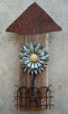 Barnyard flowers out of scrap metal and wood