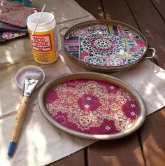 Take old metal or wooden trays, use Mod Podge to glue colorful art paper. Smooth out the paper and let it dry. Once dried, apply a coat of Mod Podge on the top tray and let it dry again.