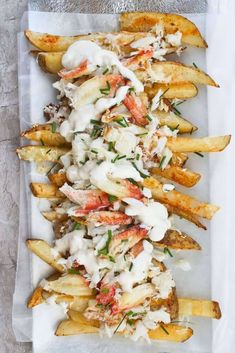 Crab Fries - with Fresh OR Canned Crab Meat - Champagne Tastes - Learn how to make crab fries! These baked fries are loaded with cheese, garlic yogurt sauce, green onions or chives, and are an easy seafood appetizer or game day side dish. Seafood Appetizers, Seafood Dinner, Appetizer Recipes, Crab Appetizer, Seafood Pasta, Party Appetizers, Seafood Nachos, Simple Appetizers, Seafood Bake