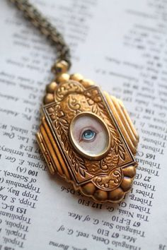 Vintage brass etched cathedral  locket casing with a 1/2 inch Lover's Eye portrait (newly painted by mabgraves) set into the center of the cover.