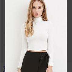 Forever 21 white crop turtle neck. First photo is the exact top. Photo credit F21 stock photo. Size small. never ever worn Forever 21 Tops Crop Tops