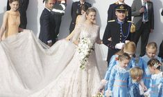 The 500,000 euro wedding: Belgian countess shimmers in breathtaking lace dress as she marries heir to the Luxembourg throne in lavish ceremony