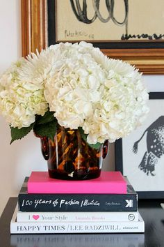 A mix of white flowers looks chic.  love the books!  Ck out K's for the titles or similar.