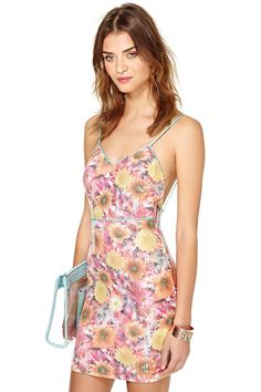 You'll never get tired of rocking this dress.  It has a slip-silhouette, vintage-inspired print, ...