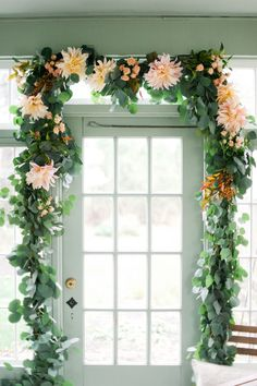 Eucalyptus garland with accents of dahlias can be hung on the barn/french doors during the ceremony to be repurposed to decorate the sweet heart, card and guestbook pulling double duty (garland will be cut in three pieces).