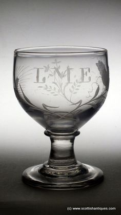 "SOLD - Engraved Georgian Glass Rummer c1820 Period : George III Origin : English Bowl : Cup Bowl Features : Engraved with hop leaves and flowers and barley, flowers and the initials L.M.E. Foot : Conical Glass Type : Clear Lead Size : 5½"" tall with 3¾"" bowl and 3½"" foot     http://scottishantiques.com/Georgian-drinking-glasses/rummers/The-LME#.V9iCAWZ2lpc"