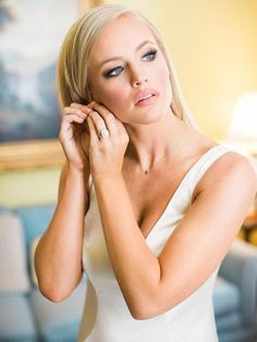 Set off your eye makeup with a little bit of highlighting and a neutral lip color for a glamorous wedding day look.