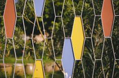 Mid Century fence with geometric pattern and colorful cells.