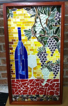 """""""Wine & Grapes"""" Commission: 18"""" x 28"""" stained glass mosaic mixed with ceramic, stone and glass beads. I custom made this to go in a yellow kitchen (in Wilmington, NC) with some rich reds and blue. It's a perfect fit."""
