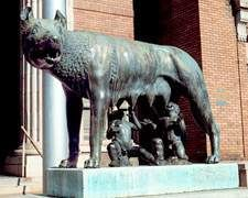 """Rome, GA- Bronze replica of original Romulus and Remus sculpture at  the Pallazio Del Conservatori in Rome, Italy, presented to Rome, Georgia, on July 30, 1929. Placed on a base of white marble from Tate, Ga., the replica was accompanied by a brass plaque that reads: """"This statue of the Capitolene Wolf, as a forecast of prosperity and glory, has been sent from Ancient Rome to New Rome during the consulship of Benito Mussolini in the year 1929."""""""