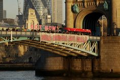 "<p>Campaigners hold a banner reading ""Build Bridges Not Walls"" from Tower Bridge in London, to protest Donald Trump's inauguration as U.S. president(AP Photo/Matt Dunham) </p>"