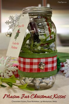 Mason Jar Kisses Kit Gift: Chocolate Kisses, Faux Mistletoe, Lip Moisturizer, Mints all in a decorative mason jar.