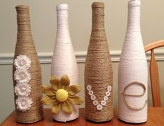 Twine/yarn wrapped decorative LOVE wine bottles for the center pieces just another look