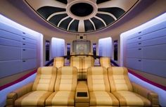 This home theater is modeled after 'The Next Generation' Enterprise, and the results are impressive. It was named the best theme theater installation at Custom Electronic Design and Installation Association 2007. The home theater installation in Palm Beach County, Florida has projection screen which is nearly 135 inches wide diagonally, apart from this it has eight servers with 3,816 DVDs.