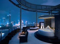 Luxurious spa tub looking out at a spectacular panoramic view of Shanghai