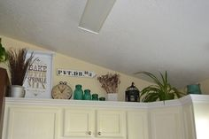 decorating above the cabinets | How to decorate the awkward space above kitchen cabinets. | decorating