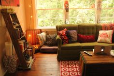 Cozy bohemian living room - love the rustic shelving, soft lighting & comfy couch. So inviting.