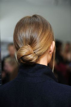 Low bun - runway hair, backstage at Fashion Palette Australia Fall/Winter 2014 RTW at New York Fashion Week. Photo by Craig Barritt.