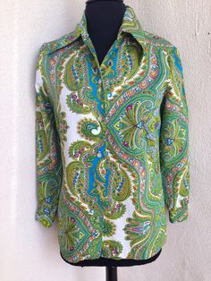 A personal favorite from my Etsy shop https://www.etsy.com/listing/292947507/vintage-blouse-greens-mod-paisley-print