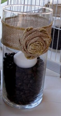 Candle jars with burlap rose from wedding reception