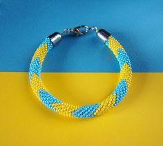 "Galina has another Ukrainian-themed bracelet for sale! We love the pattern on this bracelet.  The"" I love Ukraine"" Bracelet  by MonistoJewelry on Etsy."
