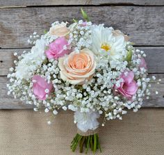Pretty peach, pink and white bouquet. Featuring Roses, Lissianthus, Dahlia and Gypsophila.