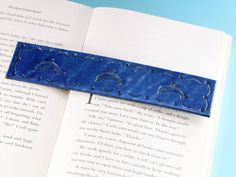 Everyone loves Dolphins!!  This handmade leather bookmark has hand-stamped dolphins and a hand-tooled border. This leather bookmark would make an ideal leather gift for friend. Also, handcrafted leather goods make great anniversary gifts. Why not check out my Etsy shop?  #bookmark #leather #anniversarygift #giftformum #dolphins #dolphinlovergift #dolphingift Leather Keyring, Leather Gifts, Leather Books, Handmade Leather, Leather Craft, Leather Bookmarks, Unique Gifts For Mom, Practical Gifts, Gifts For Mum