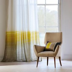 Harlequin Tranquil 130950 Cypress/Driftwood fabric from the Landscapes Voiles and Weaves collection, priced per metre. A dramatic voile in nine attractive colourways based on the wallpaper of the same name