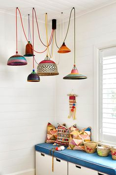 The renovation of this classic white weatherboard cottage in Byron Bay has resulted in a modern family home inspired by its coastal location and the owner's love of eclectic, colourful decor. See inside! Ikea Storage Boxes, Making Barn Doors, Oak Shelves, Coastal Cottage, Home And Family, Modern Family, Colorful Decor, Colorful Interiors, Decoration