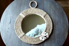 Who here is a little obsessed with all things nautical? If you raised a little hand inside just then, this project is for you! And boy is it fun! This project m… Pottery Barn Mirror, Vintage China Cabinets, Squirrel Proof Bird Feeders, Rope Mirror, Stick On Tiles, Nautical Theme, Nautical Mirror, Wine Glass Charms, Dollar Store Crafts