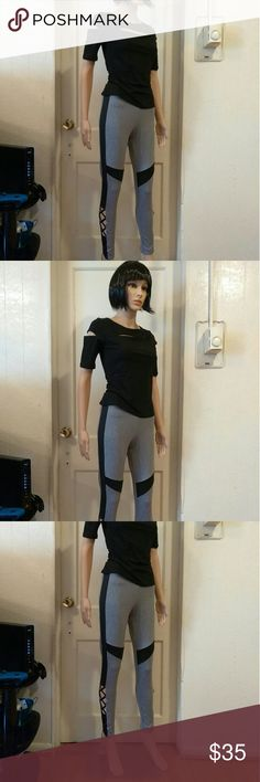 Shirt and leggings Black cut up shirt with black gray cut out yoga sport leggings leggings spandex material A+ my daughter just bought the set it's amazing Other