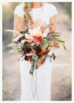 feather and floral southwestern inspired bouquet, by Jose Villa. I would love this bouquet for my wedding day. Bouquet Bride, Fall Wedding Bouquets, Floral Wedding, Wedding Flowers, Feather Bouquet, Elegant Wedding, Wedding Colors, Bouquet Wrap, Rustic Bouquet