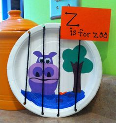 Letter of the day: z for zoo Glue pictures of animals on paper plate, punch holes and thread yarn though and tie in back.