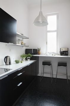 black cabinets; white countertop - for kitchenette in office