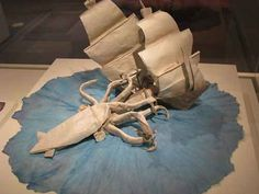 Origami giant squid attack - this entire piece is made of folded paper, ship, squid and all. Very impressive.  (listsoplenty.com)