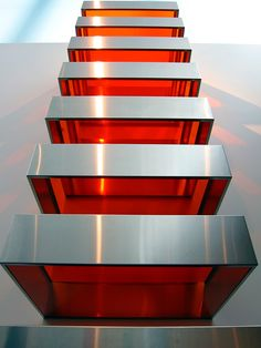 """""""Well, I am not interested in the kind of expression that you have when you paint a painting with brush strokes. It's all right, but it's already done and I want to do something new.""""    Large Stack (1968) by Donald Judd"""