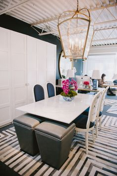 Rethink the traditional conference room or meeting space by using a dining table and chairs as opposed to your standard office supply furniture.