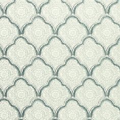 Kashmira Wallpaper A wallpaper featuring an overlapping lattice of shell shapes in a hand block print style, printed in aqua on an off-white background. Charming in the flesh. Feminine but geometric. T's room?