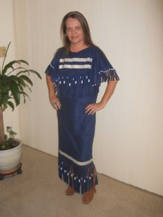 This design can be done in buckskin (shown here in a faux suede) it is fringed at the sleeve across the front of chest and across the back and around the bottom and adorned with beads.