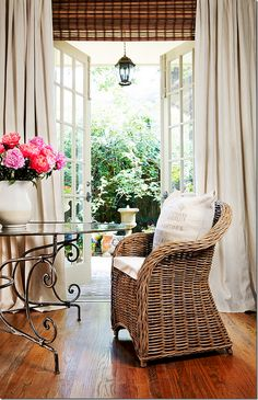 LOVE the wicker, detailed iron table, pink peonies, and EVERYTHING ELSE~! French door layering in home of Joni Webb, Cote de Texas Drapes and rolled up blinds Style At Home, Bamboo Blinds, Woven Blinds, Matchstick Blinds, House Blinds, White Curtains, Blinds Curtains, Drapery Panels, Banquette