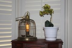 this is so cute with the little birdie on the top! hey, whats that light doing in my house? haha    Vintage birdcage lamp by VintageIlluminations on Etsy, $140.00