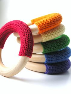 This would be neat to try and make. Good gift idea for moms. Waldorf-Baby-Teething- WOOD n WOOL- Natural Maple Wood Crochet Teething Ring Baby Toy- Rainbow Colors- via Etsy.
