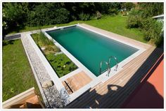 This is an example of the natural swimming pool I LOVE for the new hosue.