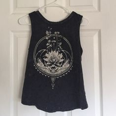 Muscle open back tee It's meant to have holes everywhere and to be distressed really cute! Worn a couple times Urban Outfitters Tops Muscle Tees