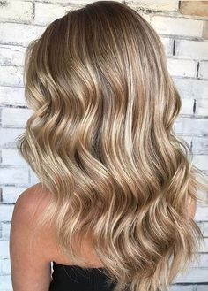 Searching for latest combinations of hair colors? No need to worry, just visit this post for updated trends of toasted coconut hair colors for long wavy hairstyles and haircuts. This is one of the best hair colors that ladies are wearing around the world.