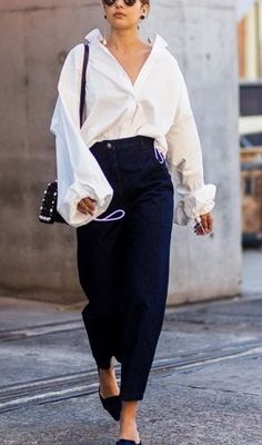We love this street style look from Australian fashion week. This white button down with bell sleeves is so on trend for summer..