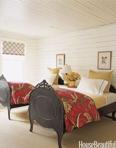 Designer Tom Stringer used antique French steel beds warmed by gold- and white-dotted quilts in this guest room. Featured in the February 2008 issue.